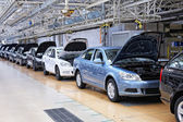 Cars in a row at car plant — Stock Photo