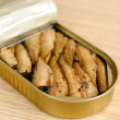 Stock Photo: Appetizing sprats in tin
