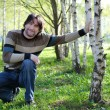 Middle-aged man in a birch grove — Stock Photo #10365198