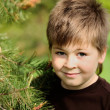 Boy in park near Pine — Stock Photo #10631292