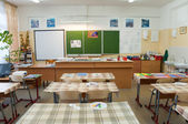 Classroom before the lesson, desks are covered with oilcloth — Stock Photo