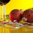 Stock Photo: New Year's still life - glasses of wine and Christmas balls