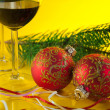 New Year's still life - glasses of wine and Christmas balls — Stock Photo #8035191