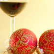 New Year's still life - glasses of wine and Christmas balls — Stock Photo #8054877