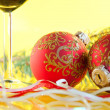 New Year's still life - glasses of wine and Christmas balls — Stock Photo #8054881