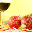New Year's still life - glasses of wine and Christmas balls — Stock Photo #8054885