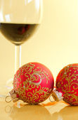 New Year's still life - glasses of wine and Christmas balls — Stock Photo