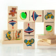 Children's wooden dominoes on a light background - Stock Photo