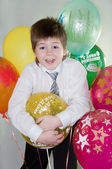Birthday. The boy with balloons of different colors — Stock Photo