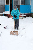 Boy removes snow around the House — Stock Photo