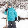 A boy with a wooden shovel for snow removal — Stock Photo #8505672