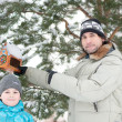Dad, son and feeding for birds in winter — Stock Photo #8579373