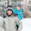 Dad and son walking in a winter park — Stock Photo
