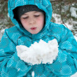 The Boy in the snowy winter park — Stock Photo