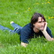 Middle-aged man is resting on the grass — Foto de Stock