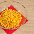 Canned corn in the salad bowl - Stock Photo
