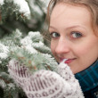 Young woman in snow-covered spruce forest — ストック写真 #9213726