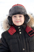 Portrait of a boy in a jacket with fur — Stock Photo