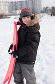 Portrait of a boy with a sledge — Stockfoto