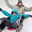 Dad and son riding a frozen hill — Stock Photo #9318317