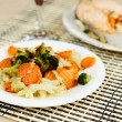 Tasty steamed vegetables on a white plate — Stock Photo