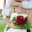 Foto Stock: Groom and bride with wedding bouquet