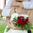 图库照片: Groom and bride with wedding bouquet