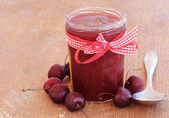 Cherry homemade jam on wooden background — Stock Photo