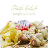 Shish kebab(greek souvlaki) with fried potato and salad — Stock Photo