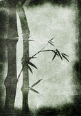 Grungy Background.old paper with bamboo branches — Stock Photo