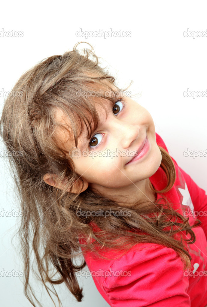 A smiling girl on the white  Stock Photo #8842479