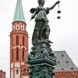Fountine with Lady Justice statue in Frankfurt - Stock Photo
