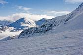Ski slope in winter mountains — Stock Photo