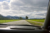 View from the car window to the road and mountain landscape — Stock Photo