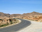 Desert highway among mountains — Stock Photo