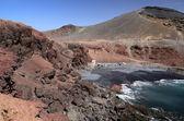 Ocean bay with volcano hills — Stock Photo