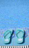 Blue flip flops near pool — Stock fotografie