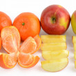 Whole and sliced fruits — Stock Photo