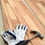 Carpenter tools on new panels floor — Stock Photo