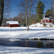 Winter landscape with Swedish cottage - Stock Photo