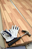 Carpenter tools on new panels floor — Stock Photo