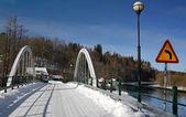 Winter bridge over the river — Stock Photo