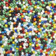Many-colored mix of beads — Stock Photo #9539828