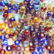 Many-colored mix of beads — Stock Photo