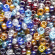 Many-colored mix of beads — Stock Photo #9539903