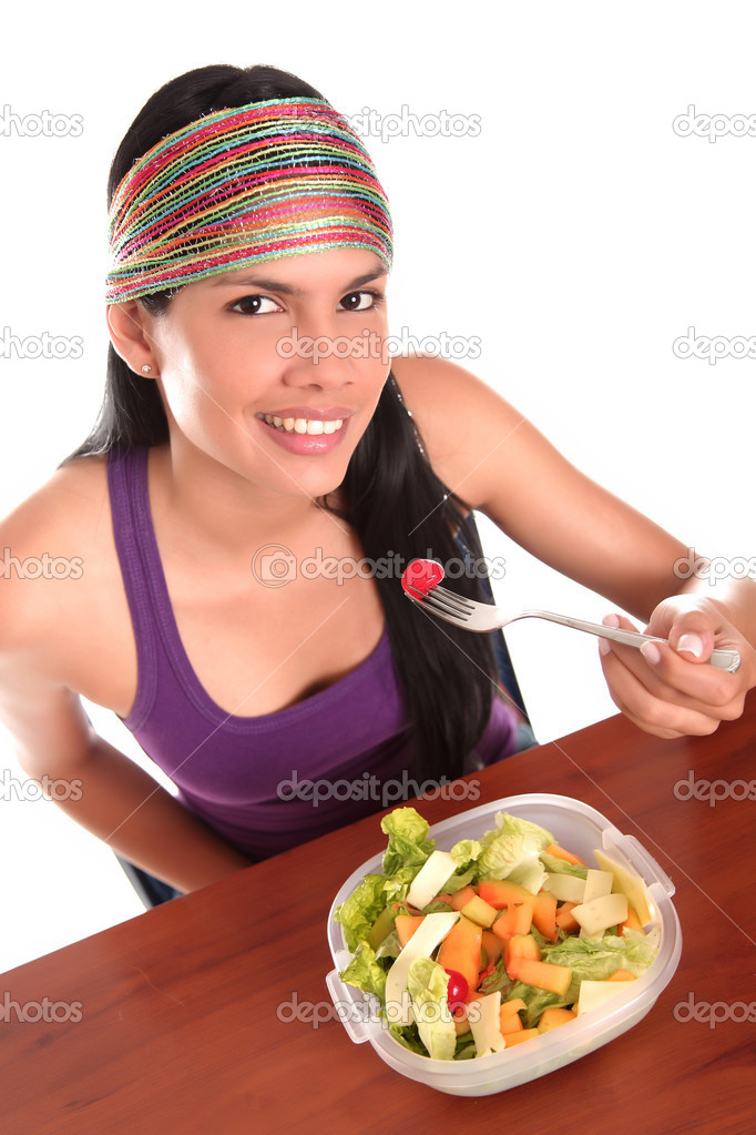 Young woman eating salad and looking up — Stock Photo #10344160