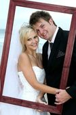 Beautiful Wedding Couple with Frame — Stock Photo