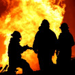 Three fire fighters and huge flames — Stock Photo #8955367