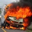 Burning Delivery Vehicle and Police Cars - Stock Photo