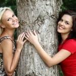 Tree Hugging Pretty Girls — Stock Photo